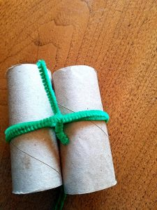 twist the extra pipe cleaner around both toilet paper rolls to make the binoculars more sturdy and able to with stand the beating toddlers are bound to give