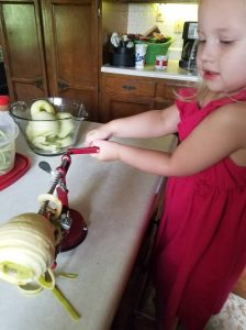 Adella helping peel and core the apples
