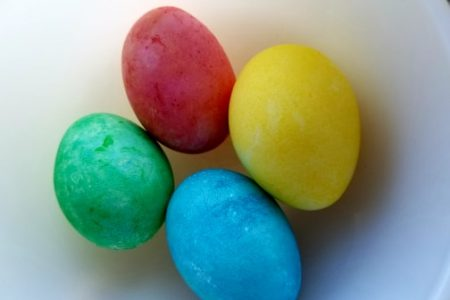 eater eggs dyed with rice and food coloring, red, blue, green and yellow
